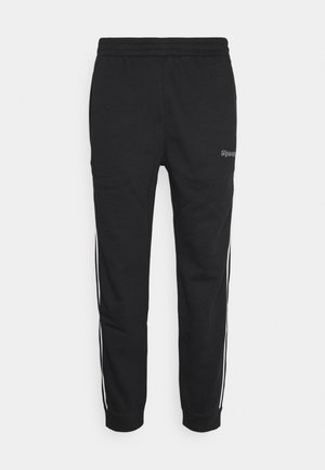 TRAINING ESSENTIALS PIPING - Tracksuit bottoms - black