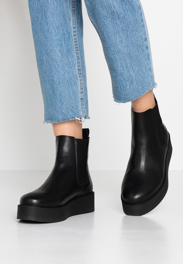 ZURI - Ankle boots - black