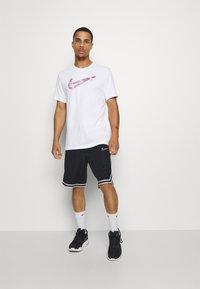Nike Performance - DRY MEDALLION TEE - T-shirts print - white - 1