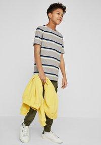 s.Oliver - Print T-shirt - grey melange stripes - 0