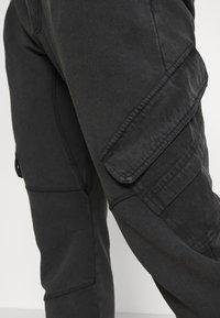 Tigha - BONO - Cargo trousers - vintage black - 4