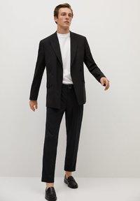 Mango - BRETON - Pantalones chinos - black - 1