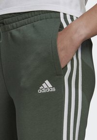adidas Performance - ESSENTIALS FRENCH TERRY STRIPES PANTS - Tracksuit bottoms - greoxi/white - 3