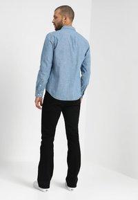 Lee - TRENTON - Straight leg jeans - black rinse - 2