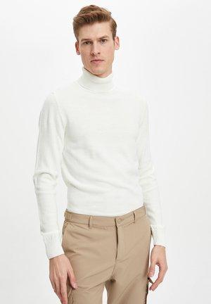 Stickad tröja - ecru