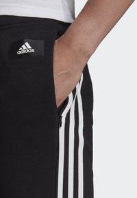 adidas Performance - ADIDAS SPORTSWEAR 3-STRIPES SKINNY PANTS - Pantalon de survêtement - black/white - 3