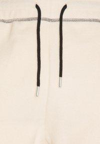 Mennace - UNISEX CONTRAST STITCH POLAR - Tracksuit bottoms - tan - 5