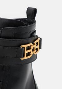 Bally - GLARIS - Cowboy/biker ankle boot - black - 6
