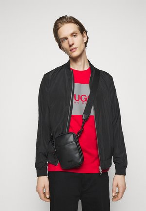 ROCKET CROSSBODY UNISEX - Across body bag - black
