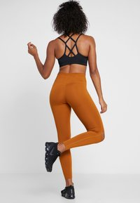 Nike Performance - REBEL ONE - Tights - burnt sienna/black - 2