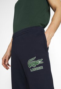 Lacoste - Tracksuit bottoms - navy blue - 8