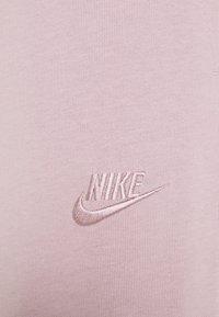 Nike Sportswear - NSW CAPRI JRSY - Tracksuit bottoms - plum chalk/plum chalk - 2
