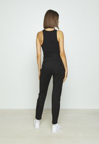 Vero Moda - VMEVA PANT - Trousers - black - 2