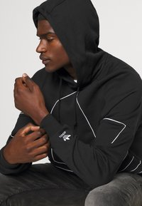 adidas Originals - OUT HOODY - Hoodie - black/white - 4