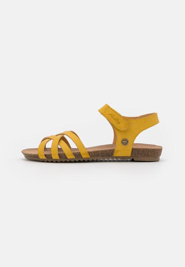 Sandaalit nilkkaremmillä - gelb