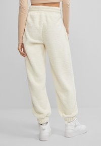 Bershka - Tracksuit bottoms - white - 2