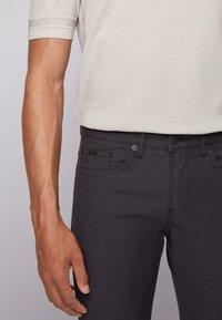 BOSS - DELAWARE - Jeans slim fit - black - 3