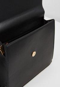 Pieces - CHRIS CROSS BODY - Handbag - black/gold - 3
