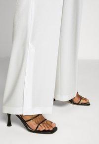 HUGO - HANIAS - Trousers - natural - 3