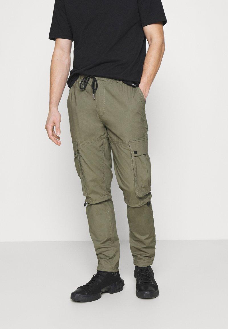 Topman - TECH BUNGEE - Cargo trousers - khaki