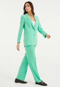 WE Fashion - Trousers - bright green - 4