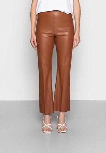 KAYLEE KICKFLARE PANTS - Kalhoty - rubber