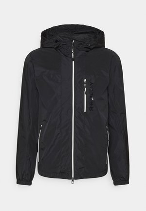 JACKET - Waterproof jacket - black