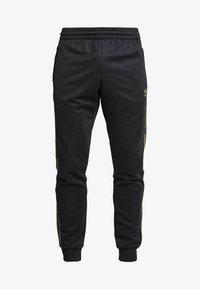 adidas Originals - CAMO - Spodnie treningowe - black/multicolor - 3