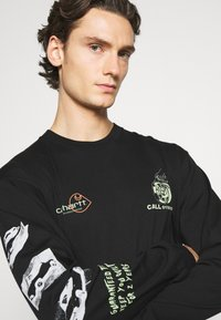Carhartt WIP - RACE PLAY - Long sleeved top - black - 3