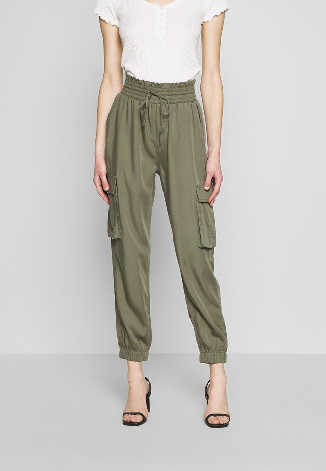 JOGGER - Trousers - green