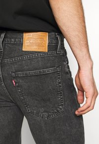 Levi's® - SKINNY TAPER - Vaqueros pitillo - black denim - 3