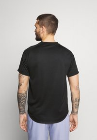 Nike Performance - T-shirt - bas - black/black/white - 2
