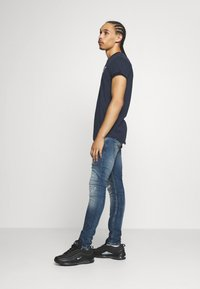 Tigha - MORTEN REPAIRED - Jeans slim fit - mid blue - 3