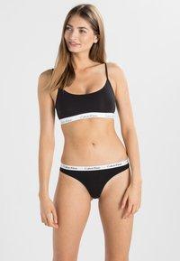 Calvin Klein Underwear - THONG 3 PACK - Tanga - black - 0