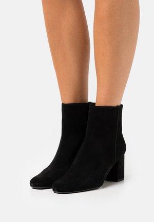 BOLOGNA - Kotníkové boty - black