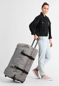 Eastpak - TRANVERZ L - Wheeled suitcase - sunday grey - 0