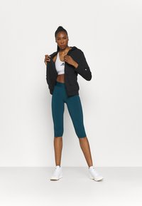 adidas Performance - CAPRI - 3/4 sports trousers - teal - 1