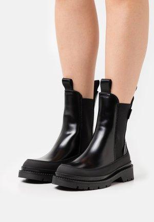 PREPNOVO - Platform ankle boots - black