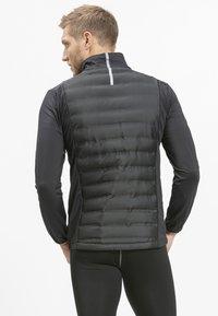 Endurance - MIT WARMER WINTERSTEPPUNG - Outdoor jacket - black - 2