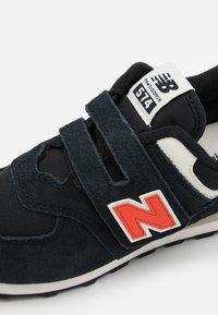 New Balance - PV574ML2 UNISEX - Trainers - black - 5