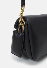 Coach - COVERED CLOSURE PILLOW TABBY SHOULDER BAG - Handbag - black - 4