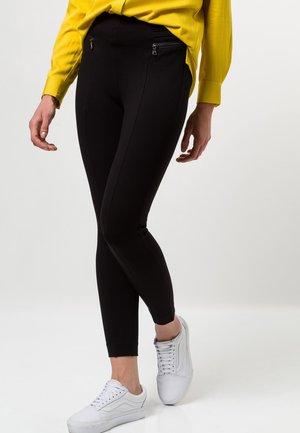 MIT ZIPTASCHEN - Leggings - Trousers - black