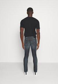 Diesel - THOMMER - Jeans slim fit - dark blue denim - 2