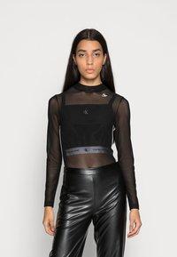 Calvin Klein Jeans - Long sleeved top - black - 0