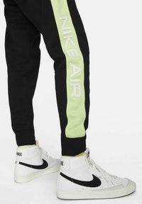 Nike Sportswear - AIR - Tracksuit bottoms - black/light liquid lime/white - 4