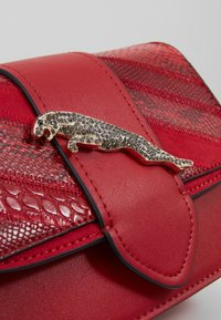 Topshop - LEAPING LEOPARD XBODY - Torba na ramię - red - 6