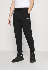 Calvin Klein - SMALL LOGO - Verryttelyhousut - black - 0