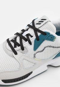 adidas Golf - ADIC ZX PRIMEBLUE - Golf shoes - footwear white/core black/orbit indigo - 5