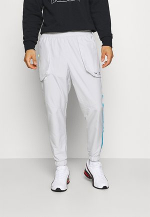 TRAIN FIRST MILE XTREME  - Tracksuit bottoms - gray violet
