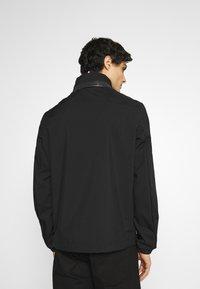 Tommy Hilfiger - STAND COLLAR JACKET - Lehká bunda - black - 5